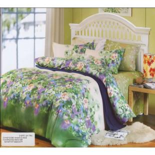 Постельное белье изумрудного цвета с фиолетовыми цветами твил