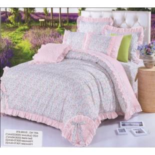 Голубое постельное белье с розовыми рюшечками в мелкий принт